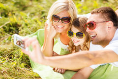 Happy family with camera taking picture Stock Images