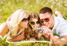 Happy family with camera taking picture Stock Photography