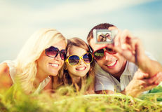 Happy family with camera taking picture Royalty Free Stock Photo