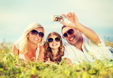 Happy family with camera taking picture Royalty Free Stock Photography