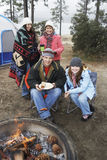 Happy Family At Campfire In Winter Royalty Free Stock Photo