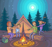 Happy family camping with campfire at night. Royalty Free Stock Image