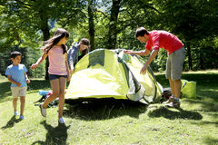 Happy family camping in forest Royalty Free Stock Photography