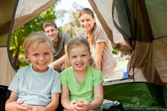 Happy family camping in the park. With a tent Stock Photos