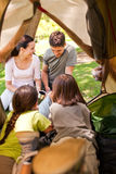 Happy family camping in the park. With a tent royalty free stock image