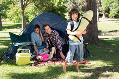 Happy family on a camping trip Stock Photos