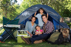 Happy family on a camping trip in their tent Royalty Free Stock Photography