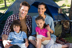 Happy family on a camping trip in their tent Royalty Free Stock Photo
