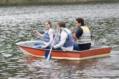 Happy Family Canoeing on Lake Stock Photo