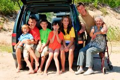 Happy family by car. Whole family looking at camera Stock Photos