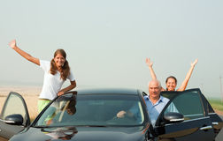 Happy family  by car Stock Images