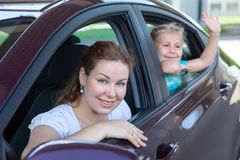 Happy family in car Stock Images