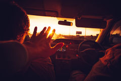 Happy Family in a Car enjoy vacations. Hand touching sunset lights Lifestyle Travel concept Stock Photos