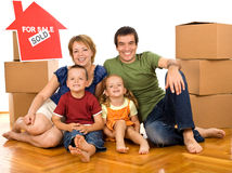 Happy family with cardboard boxes Stock Photos