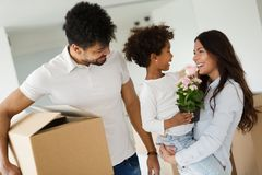 Happy family with cardboard boxes. Moving concept Royalty Free Stock Photo