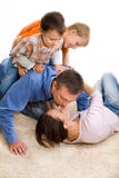Happy family on the carpet Stock Photography