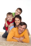 Happy family on a carpet Royalty Free Stock Image