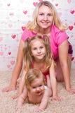 Happy family on the carpet Stock Photos