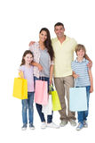 Happy family carrying shopping bags Stock Images