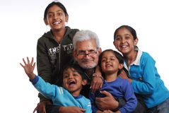 Happy family in casual dress. Cheerful grand children with grand father Royalty Free Stock Image