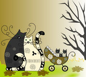 Happy family, cat, cat and kittens in a wheelchair Stock Photography