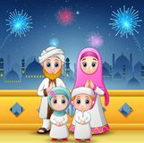 Happy family celebrate for eid mubarak with mosque and fireworks background Stock Photo