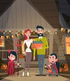 Happy Family Celebrate Halloween Parents And Kids Wear Vampire Costumes Holiday Decoration Horror Party Concept. Flat Vector Illustration Stock Photo
