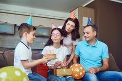 Family celebrates birthday with a birthday cake. Happy Family celebrates birthday with a birthday cake stock photos