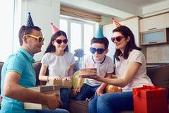 Happy Family celebrates birthday with a birthday cake.  royalty free stock image