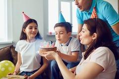 Happy Family celebrates birthday with a birthday cake.  stock photos