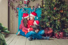 Happy family celebrates Christmas. Mom, Dad and Son in Christmas stock image