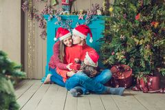 Happy family celebrates Christmas. Mom, Dad and Son in Christmas royalty free stock photography