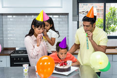 Happy family celebrating a birthday. At home in the kitchen royalty free stock image