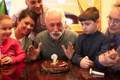 Happy family celebrating a birthday royalty free stock images