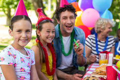 Happy family celebrating a birthday. In the park royalty free stock image