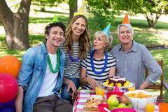 Happy family celebrating a birthday. In the park stock photography