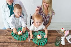 Happy family celebrating a birthday party birthday of the daughter. Top view royalty free stock image