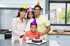 Happy family celebrating a birthday. Portrait of happy family celebrating a birthday royalty free stock image