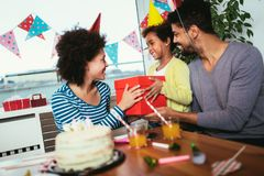 Family celebrating a birthday together at home. Happy family celebrating a birthday together at home royalty free stock photos