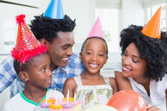 Happy family celebrating a birthday together. At home in the kitchen stock photo