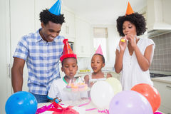Happy family celebrating a birthday together. At home in the kitchen stock photos