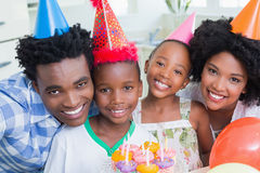 Happy family celebrating a birthday together. At home in the kitchen royalty free stock images