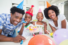 Happy family celebrating a birthday together. At home in the kitchen royalty free stock photography