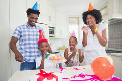 Happy family celebrating a birthday together. At home in the kitchen royalty free stock image