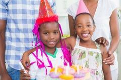 Happy family celebrating a birthday together. Happy family celebrating a birthday at home in the kitchen royalty free stock photos