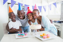 Happy family celebrating a birthday together. At home in the kitchen royalty free stock photos
