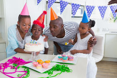 Happy family celebrating a birthday together. At home in the kitchen stock image
