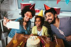 Family celebrating a birthday together at home make selfie. Happy family celebrating a birthday together at home make selfie stock photography