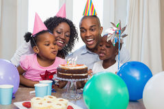 Happy family celebrating a birthday together at table Royalty Free Stock Image