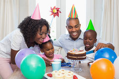 Happy family celebrating a birthday together at table Stock Images